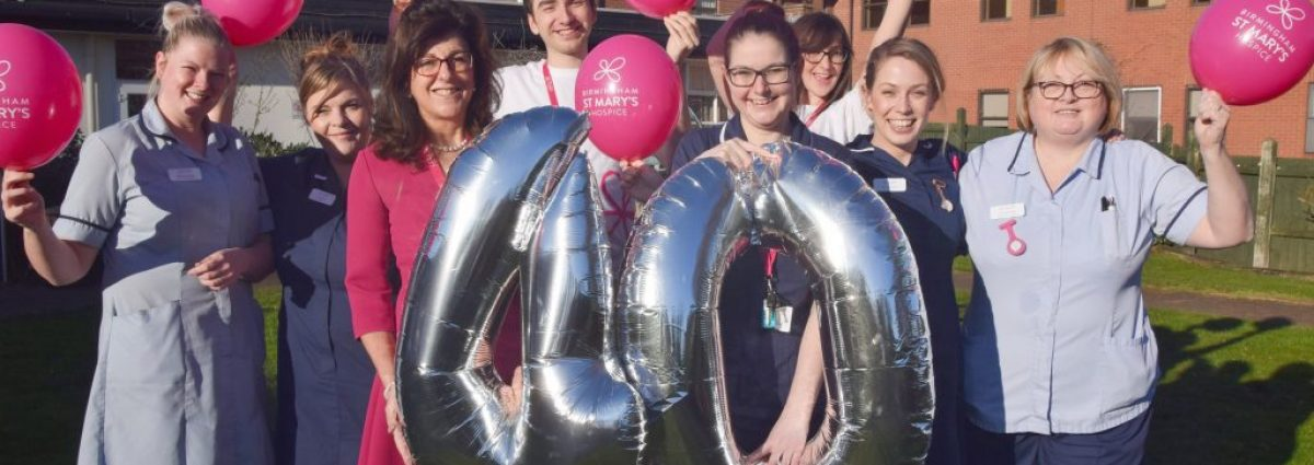 Birmingham St Mary's chief executive, Tina Swani, celebrates the Hospice's 40th with staff