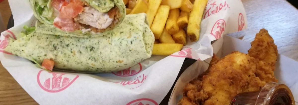 A Slim's Wrap, skin on fries and three tenders photo by Dave Massey