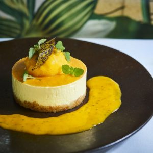 The Ivy Collection - Vanilla cheesecake with mango, passion fruit and tropical sorbet
