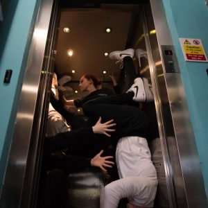 Reimagine - Dancers in a lift photo by Mark Anderson